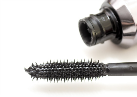 macro image: Macro image of a black mascara on a white background. Stock Photo