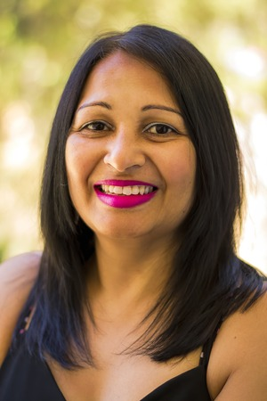 indian ethnicity: Portrait of a middle aged smiling asian woman.