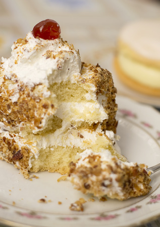caloric: Yummy creamy cake with a cherry on top.