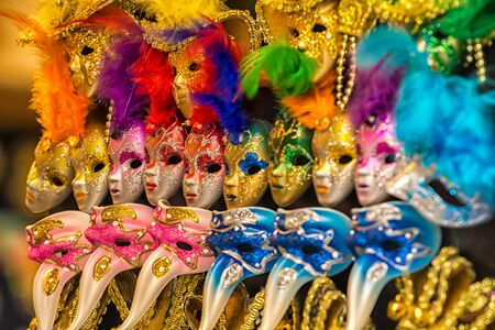 venice carnival: Colorful carnival masks on the market in Venice, Italy.
