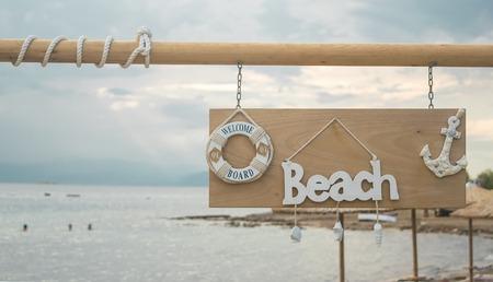Fun beach sign at the a touristic beach in Greece.