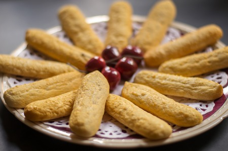 shortbread: Home made shortbread biscuits on a plate with cherries.