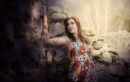 tattoed: Fantasy image of a woman standing against rocks Stock Photo