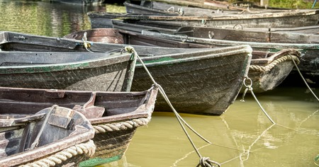 murky: Empty old wooden boats on the murky river Stock Photo
