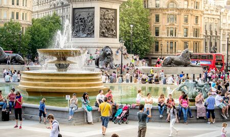the place is important: London, England - JULY 27, 2014 - Busy touristic Trafalgar square in central London, England. Trafalgar square is an important historic and touristic place in central London.