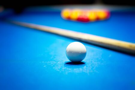 Snooker table set up with the white ball in the foreground