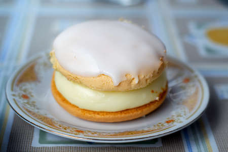 Cake with a custord filling and icing on top