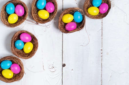 Easter background. Colourful easter eggs in nests.