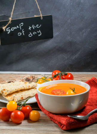 Tomato soup served with fresh cherry tomatoes Stock Photo