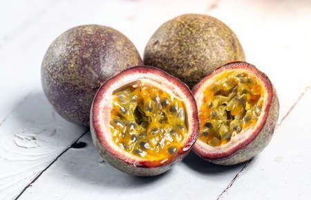 Halved passion fruit with orange seeds. Closeup macro.