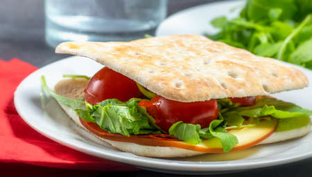 Healthy vegetarian thin sandwich with cheese and salad.
