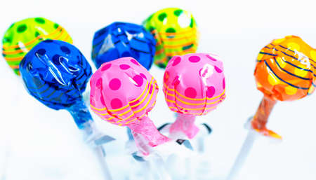 Varrious colourful lollipops on a white background