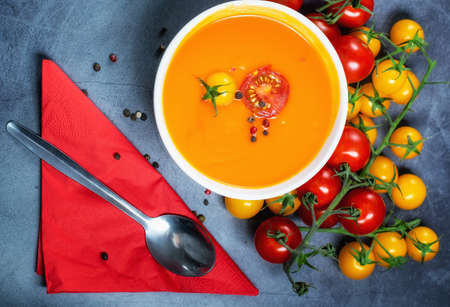Fresh tomato soup served with cherry tomatoes and black peppercorns Stock Photo