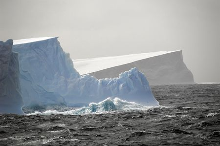 Antarctic icebergs in stormy seas Stock Photo