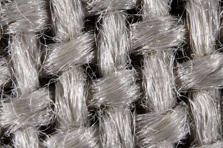 Textile structure of woven fibres