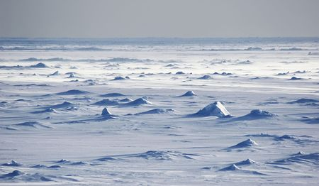 Endless Antarctic snowfields beyond horizons photo