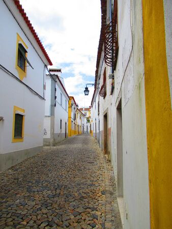 Colourful alleyway in Evora, Portugal