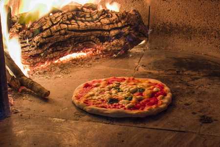 pizza maker: Margherita pizza in a wood oven