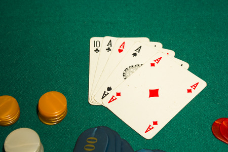 texas hold em: 5 card poker, four aces on green table gambling