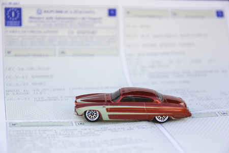 Vehicle registration certificate and vintage car