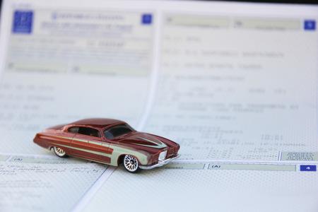 Vehicle registration certificate and vintage car Stock fotó - 112650319