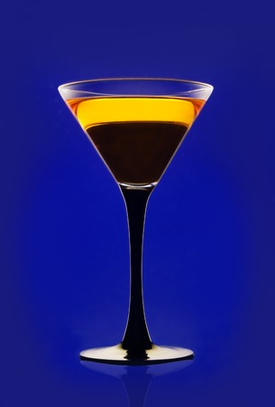 Yellow cocktail on a blue background photo