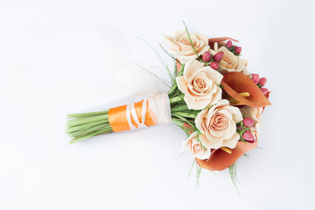 Colorful bouquet of orange calla lilies on a white background photo