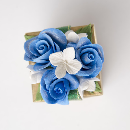 Gift box with blue rose on white background with clipping path. photo