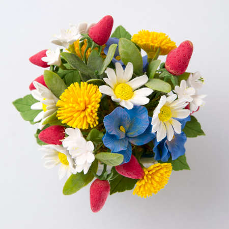 Colorful bouquet of flowers and berries on a white background photo