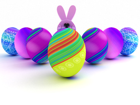 Easter bunny and colorful eggs isolated on white background. 3D render. Copy space photo
