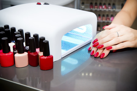 Manicure set in a beauty salon. Beautiful female hands.