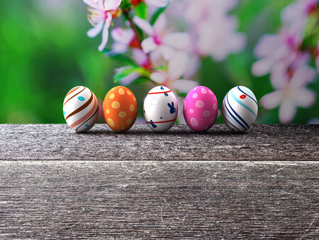Easter colorful eggs on a wooden background  3D render  Copy space photo