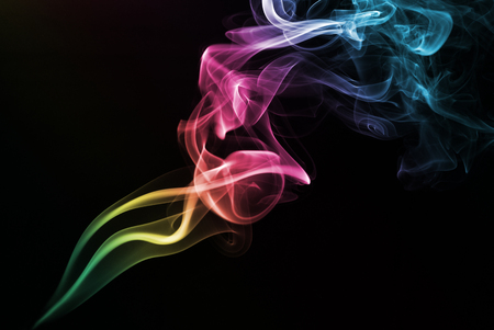 Coloured smoke isolated on black background. photo