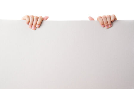 Gesture of hand holding a blank white paper isolated over white background photo