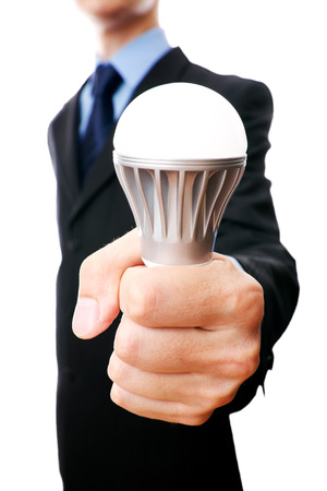Business man with LED light bulb isolated on a white background photo