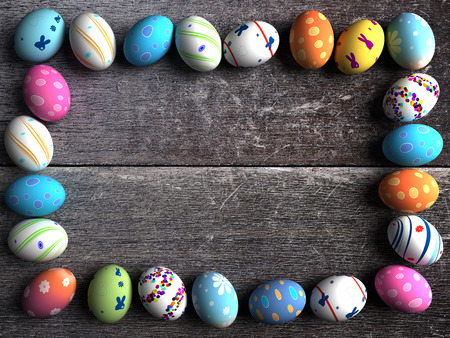 Easter colorful eggs on a wooden background photo