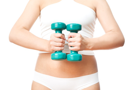 Girl with green dumbbells in hand, isolated on a white background  photo