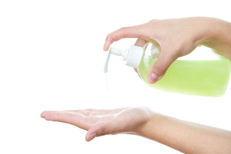Liquid soap in female hands, isolated on a white background Stock Photo - 27216464
