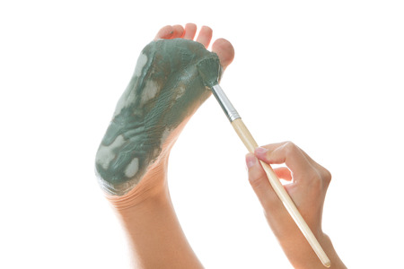 Foot Care. Mud treatment mask for leg. Stock Photo - 27217678