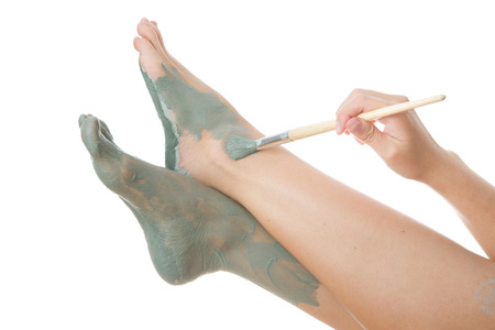 Foot Care. Mud treatment mask for leg. Stock Photo - 27217680