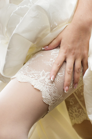White lace stockings bride  Wedding manicure  Closeup photo