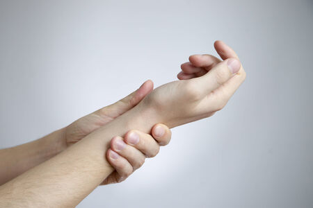 Pain in the joints of the hands  Care of male hands  Stock Photo
