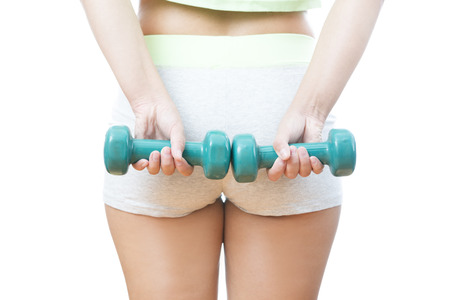 Young woman doing exercises with dumbbells  Isolated on white background  Stock Photo