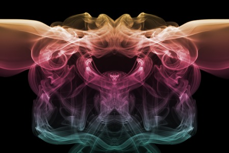 Coloured smoke isolated on black background photo