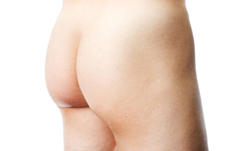 Nude male buttocks on white background photo