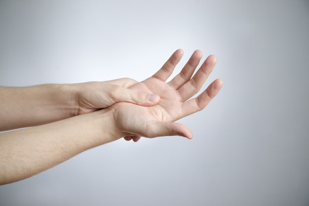 enhanced health: Pain in the palm  Care of male hands Stock Photo
