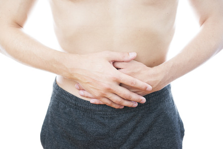 griping: Abdominal pain in men Stock Photo