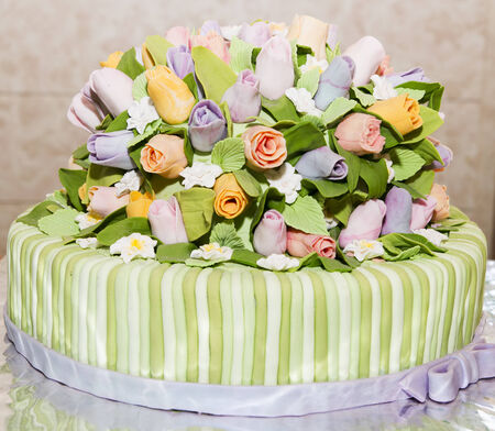 Beautiful tasty cake with roses of cream. photo