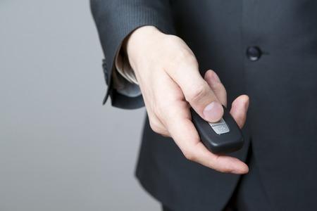 keyless: Businessman using car key. Keyless in male hand