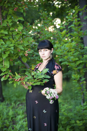 Pregnant woman relaxing on nature. photo